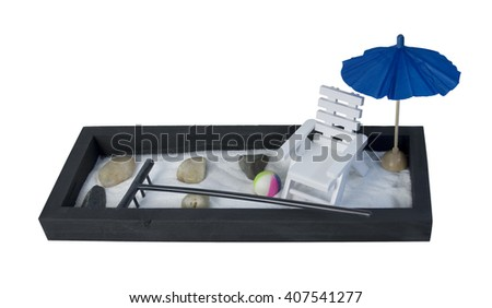 White Adirondack Chair and Umbrella on a Zen Sand Garden relaxing during leisure times - path included - stock photo