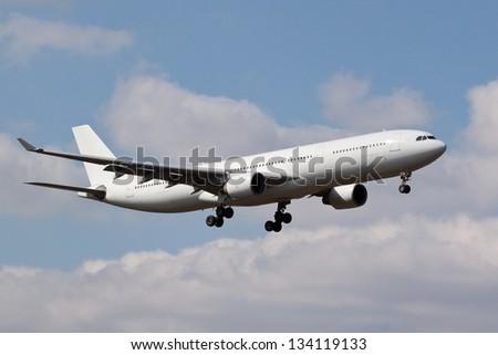 White aeroplane / airplane landing - stock photo