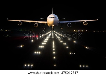 White aircraft departs from the airport Runaway in the night - stock photo