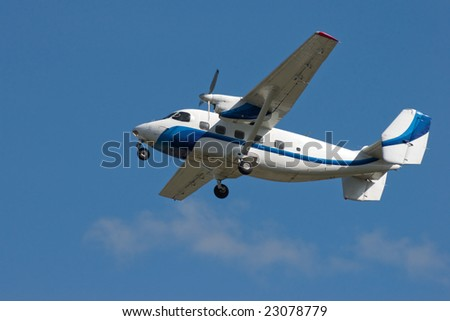 white aircraft is flying in the sky - stock photo