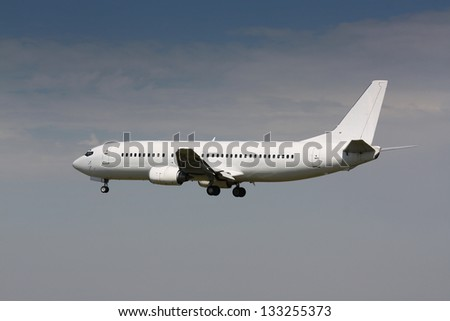 White airplane landing - stock photo