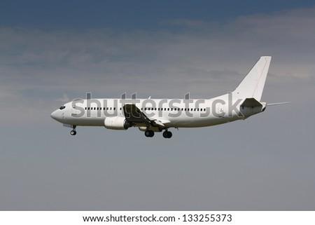 White airplane landing - stock photo