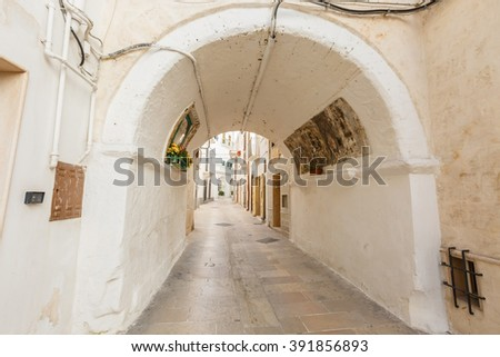 White alleyway in the fortress old town of Monopoli, Iitaly - stock photo