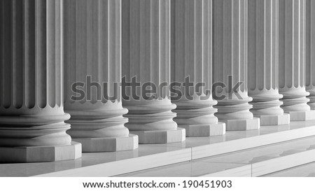 White ancient marble pillars in a row  - stock photo