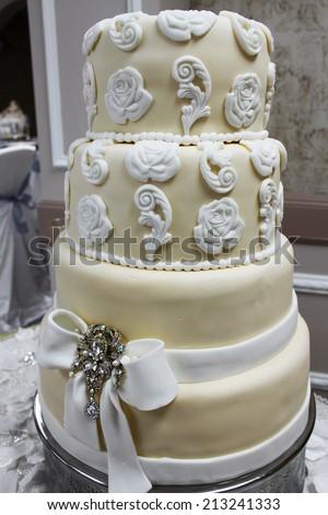 White and beige wedding cake - stock photo