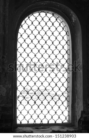 white and black Brass security window ornamentation diminishing in the Russian Orthodox Church - stock photo