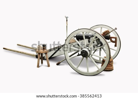 White and black cannon with complete accessories isolated in white background. - stock photo