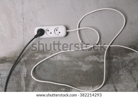 white and black electric extension cables - stock photo