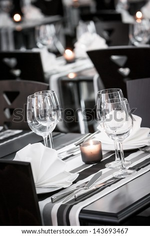 White and black restaurant table setting - stock photo