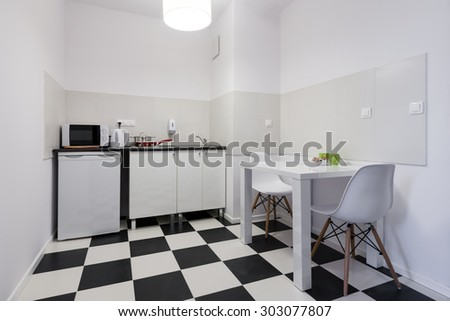 White and black small and compact kitchen interior design - stock photo