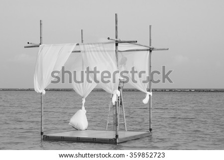 White and Black wedding arch and set up on beach - stock photo
