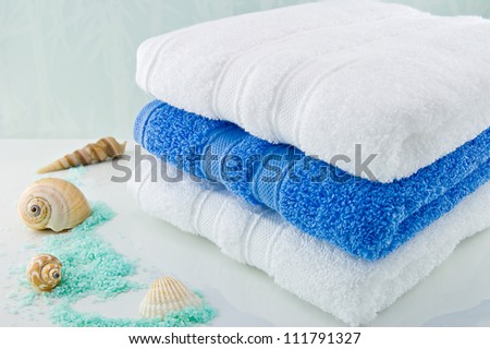 White and Blue bath towels - stock photo