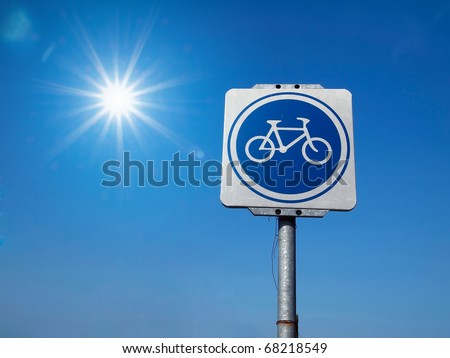 White and Blue Bicycle Traffic Sign and sky - stock photo
