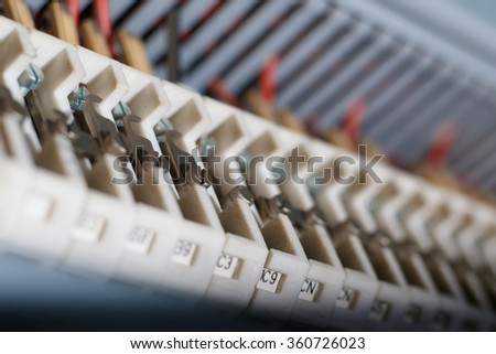 White and blue busbar for  electricity circuit - stock photo