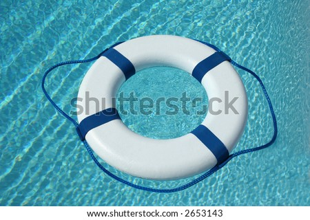 White and blue life buoy in the water - stock photo