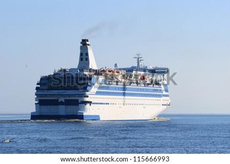 White and blue sea passanger ship - stock photo