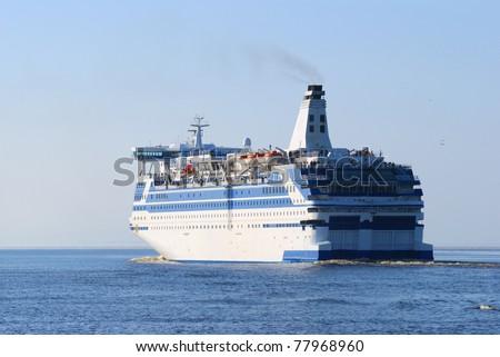 White and blue sea passenger ship - stock photo
