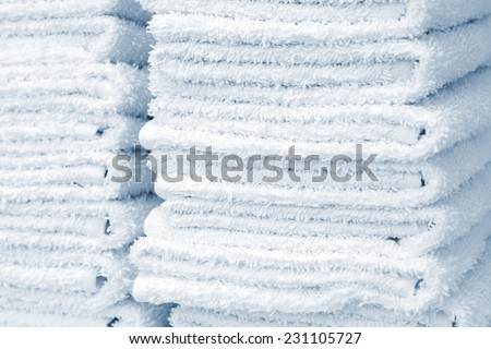 white and fluffy towels in the beauty salon - stock photo