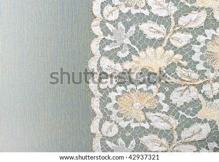 White and gold lace on the fabric. - stock photo