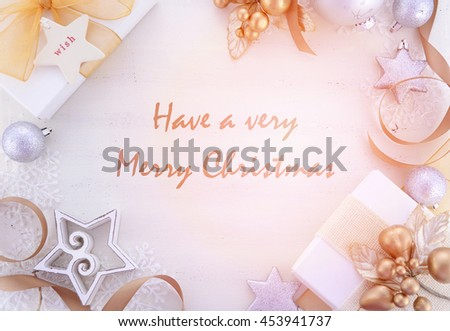 White and gold theme festive Christmas background with decorated borders and Have a Very Merry Christmas, sample text, with added retro style filters.   - stock photo