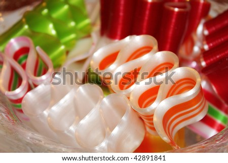 White and orange candy in a bowl - stock photo