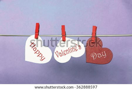 white and Red hearts with clothespins hanging on clothesline on blue background. date, love Happy Valentines Day concept. 14 february  - stock photo