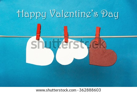 white and Red hearts with clothespins hanging on clothesline on blue background. date, love Happy Valentines Day concept. 14 february . space for Name  - stock photo