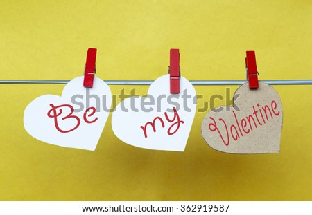 white and Red hearts with clothespins hanging on clothesline on color background. date, love Happy Valentines Day concept. Be my Valentine - stock photo