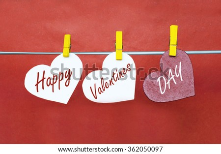 white and Red hearts with clothespins hanging on clothesline on red background. date, love Happy Valentines Day concept - stock photo