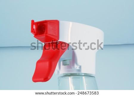 White and red plastic sprinkler. Sprayer bottle. - stock photo