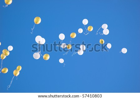 white and yellow balloons in the sky - stock photo
