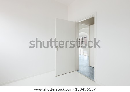 White apartment Interior, open door - stock photo