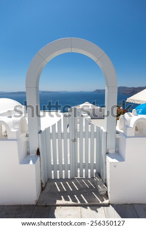White arched gateway above aegean sea in Oia, Santorini, Cyclades, Greece - stock photo