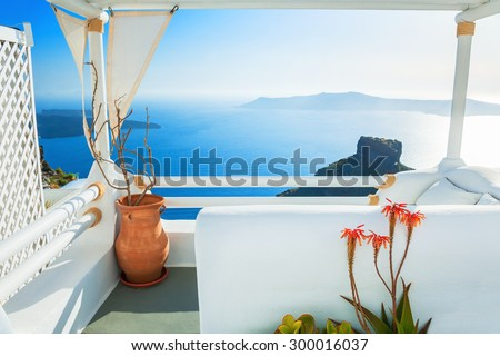 White architecture on Santorini island, Greece. Beautiful terrace with sea view at sunset. Selective focus - stock photo