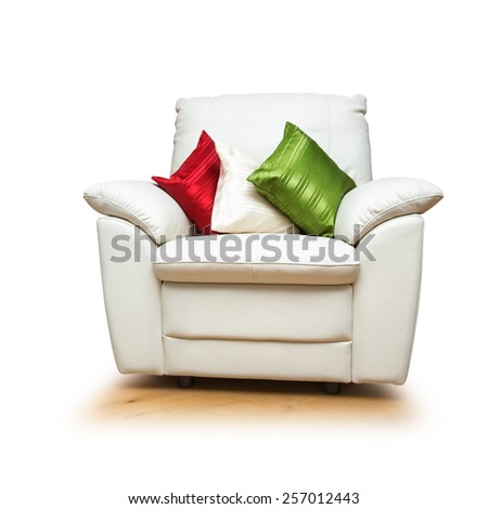 White armchair with colorful pillows isolated on white background. Object with clipping path - stock photo