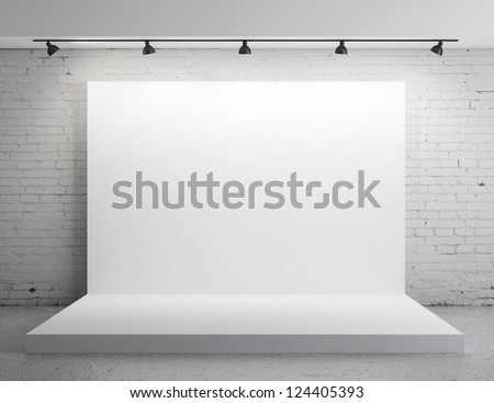 White backdrop in room with grey paint on wall - stock photo
