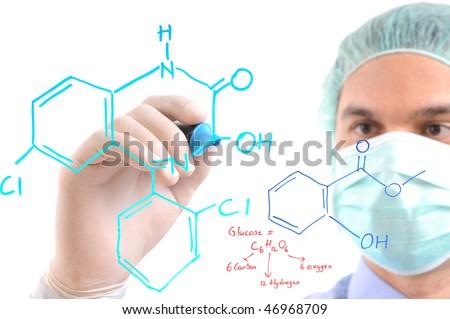 White background studio image of a  chemist writing formula on glass - stock photo