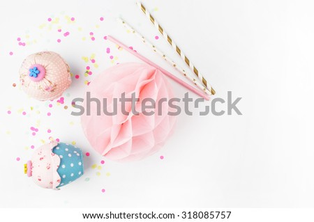 White background with party accessories. Invitation mockup. Confetti and muffins. cake - stock photo