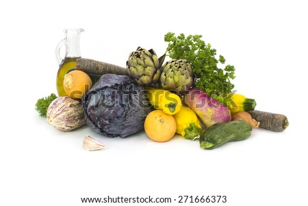White background with stack of Fresh spring vegetables - stock photo