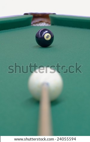 white ball, black ball and the billiard-pocket are on the same line providing the good opportunity to win the game; focus on the black ball - stock photo