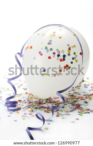white balloons on colorful confetti and streamers - stock photo