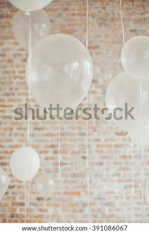 white baloons with brick wall on background - stock photo