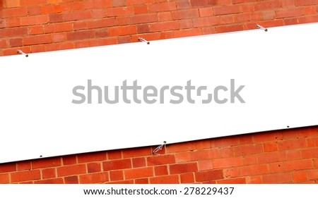 White banner against red brick wall - stock photo