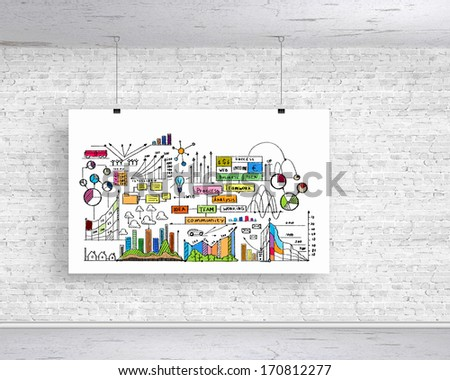 White banner with business plan hanging on wall - stock photo