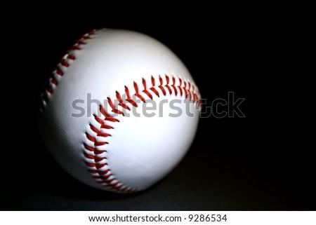 white baseball against dark background horizontal - stock photo