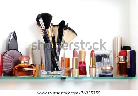 white bathroom shelf with cosmetics and  toiletries - stock photo
