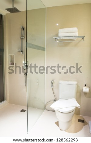 white bathroom with toilet - stock photo