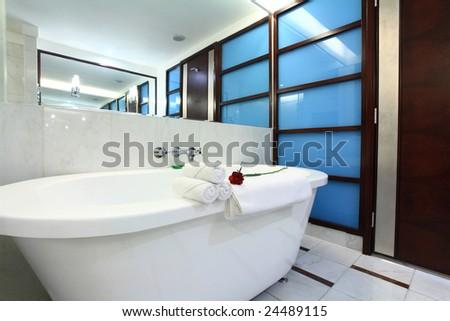 white bathtub with towel in bath room - stock photo