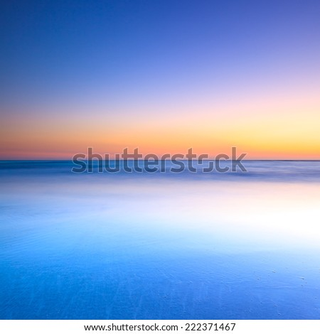 White beach, blue ocean and clear sky. Twilight sunset on background - stock photo