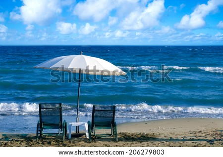 White Beach Umbrella and Chairs in Limassol, Cyprus - stock photo